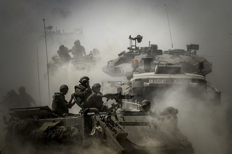 Israeli soldiers seen on tanks at an IDF staging area near the Israeli border with Gaza, on July 31, 2014.