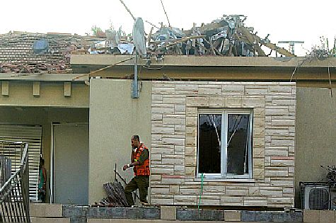 House in Ashkelon directly hit by Gaza rocket fire early morning on August 26, 2014. Six were physically wounded, including three children, and two dozen others taken to hospital to be treated for shock.