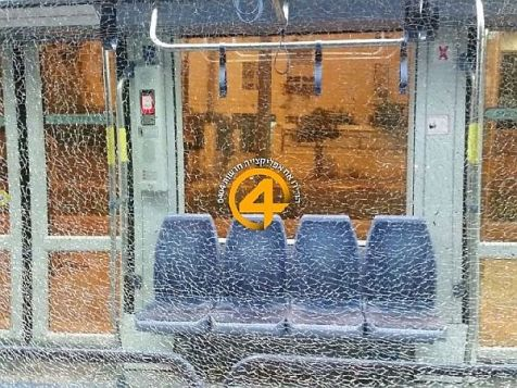 Window of the Jerusalem Light Rail smashed by rocks hurled by Arab terrorists in northern Arab neighborhood of Shuafat, August 25, 2014.