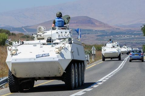 UN trucks running away from the Syrian-Israel border at the end of August 2014.
