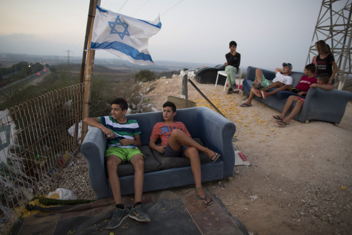 Israeli youth watch rockets flying from the Gaza Strip into Israe, August 25, 2014.