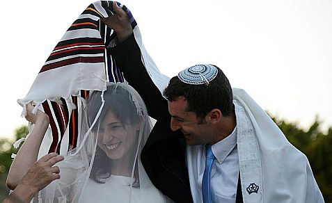 Living in Israel is an open ticket against intermarriage. Above: MK Tzipi Hotovely and Or Alon at their wedding last year.