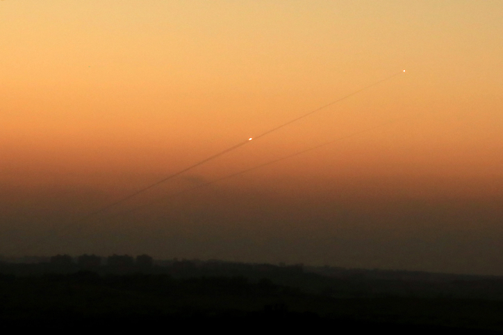 A trail of smoke is seen as a rocket is launched from the Gaza Strip towards Ashkelon, August 24, 2014.
