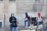 Arab teens hurling rocks and firecrackers in the Jerusalem neighborhood of Ma'ale Zeitim. (archive)