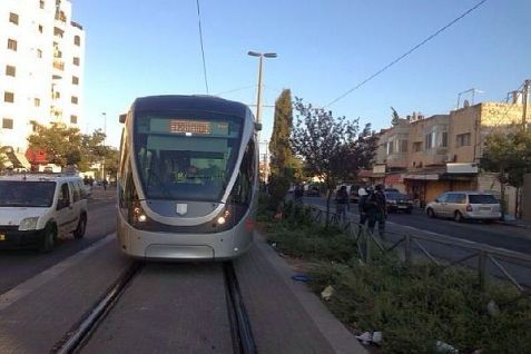 Jerusalem Light Rail traveling through a neighborhood in the capital.