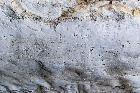 Graffiti carved into ceiling of ancient cistern by Australian soldiers during World War II.