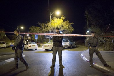 Israeli Police block the area where Temple Mount Movement Leader, Yehuda Glick, was shot by a drive-by motorist, near the Begin Center in Jerusalem.