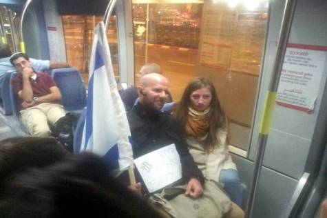 Girls from Bnei Akiva cheering up passengers on the Jerusalem Light Rail.