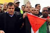 Arab MK Ahmed Tibi on the Temple Mount with PLO flag.