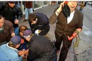 Alan Bauer's anguish captured after March 21, 2002 Arab terrorism grievously wounded his son, Yehonathan, being attended to by emergency personnel as he lay injured on the ground.