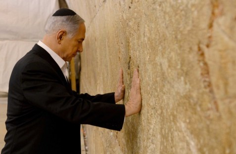Israel Prime Minister Benjamin Netanyahu prays at the Western Wall ahead of his speech next week at the US Congress.