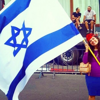 "JPreess Online blogger Jordana Brown proudly waving the ""Blue and White"""