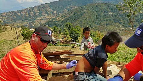 Dov Maisel of United Hatzalah gives vaccine to Nepalese boy at the IsraeLife field hospital on the outskirts of Kathmandu.