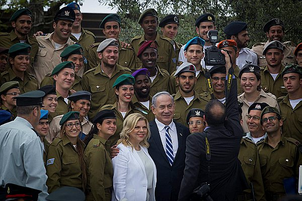 Prime Minister and Sara Netanyahu with soldiers awarded for distinguished service.