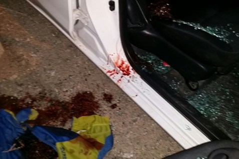 Victim's blood on car from terror attack.