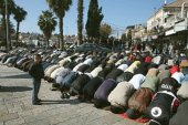 Muslims men praying at Damascus Gate.