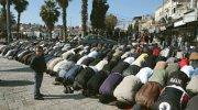 Muslims men praying at Damascus Gate.