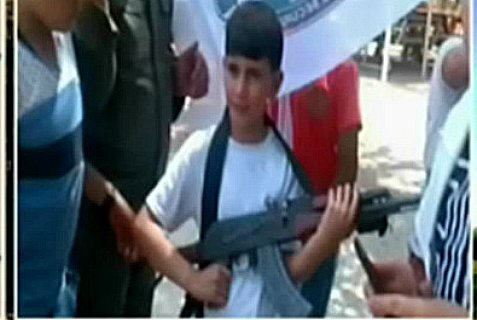 """A """"rifle-holding"""" lesson at a Palestinian Authority summer camp."""