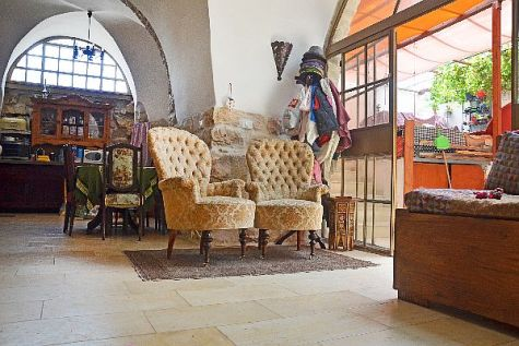 Gazing at this cozy living room one would never suspect that beneath the small throw rug lies the entrance to a 2,000 year old mikvah, a Jewish ritual pool of purification.
