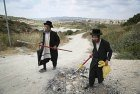 Orthodox Jews fixing an eruv pole in Israel.