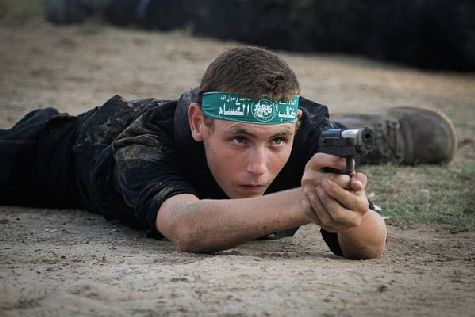 A Gaza teen exhibits his sniper skills at Hamas military summer camp.