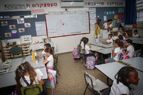 Children arrive to their first day of First Grade at Paula Ben Gurion elementary school in Jerusalem.