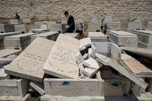 A view of desecrated tomb stones vandalized by unknown assailants in the Mount of Olives cemetery,  June 2015.