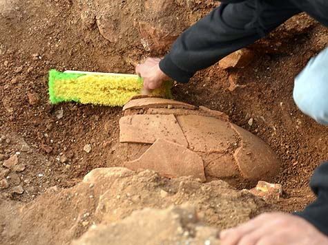 A 2,000 year old jar as it was discovered in the field.