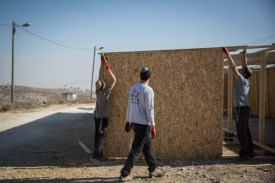Amona residents building temporary shelters for thousands of protesters expected to arrive before the Dec. 25 evacuation day.