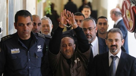 Palestinian leader Marwan Barghouti, (c.), remains wildly popular among Palestinians despite being imprisoned for life.