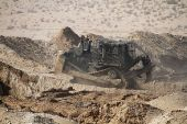 The IDF Caterpillar D9, operated by the Israel Defense Forces (IDF) Combat Engineering Corps for combat engineering and counter-terrorism operations.  (file)
