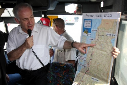 PM Netanyahu with a map of Israel