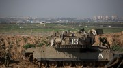 IDF soldiers in a field outside Kibbutz Nahal Oz near the Gaza border.