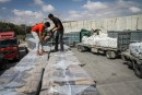 Cement shipments are carefully inspected before passing through the Kerem Shalom crossing.