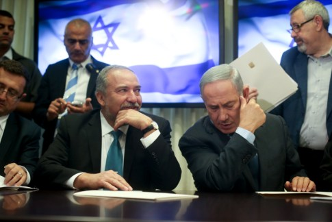 Israeli Prime Minister Benjamin Netanyahu and leader of the Israel Beyteinu political party Avigdor Liberman sign an agreement in the Israeli parliament on May 25, 2016, which will bring Israel Beyteinu into the coalition and name Liberman as defense minister.