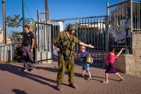An Israeli soldier guards outside a kindergarten, after earlier a Palestinian Authority terrorist stabbed an Israeli reserve IDF officer in the Judean city of Efrat, in Gush Etzion on September 18, 2016.