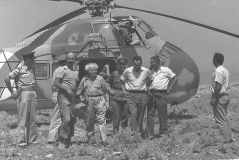 Shimon Peres (C) with then Prime Minister David Ben Gurion (L) and Dr. Yigal Yadin (R), after landing with an army helicopter at Hatzor to visit excavations, in 1958.