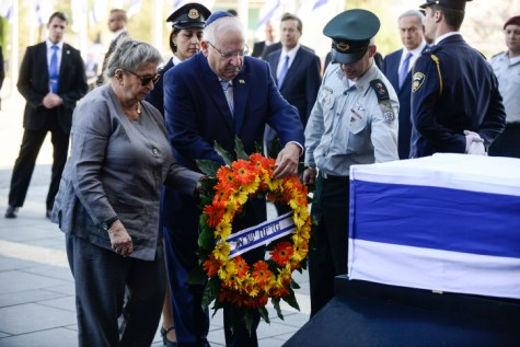 President Reuven Rivlin and his wife Nechama lay flowers at the coffin of late former Israeli president Shimon Peres where the public will be invited to pay their last respects before his burial, in Jerusalem, on September 29, 2016.