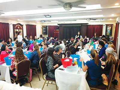 Women participating in Chabad Chayil's challah bake.