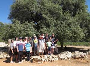 Margalit Frydman (front center) with her Eretz Yisrael Movement group at the Lone Tree in Gush Etzion.