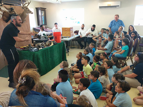 Children participate in shofar factory.