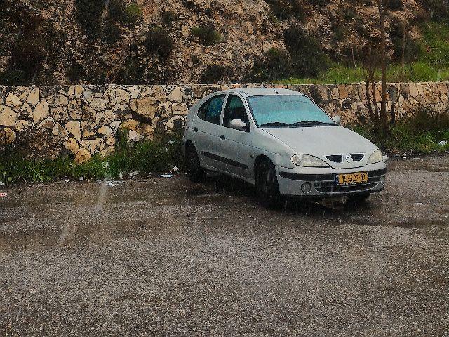 Hail pelts a car parked in Jerusalem.