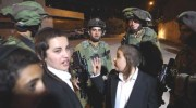 IDF soldiers and Hassidic teens outside Joseph's Tomb