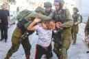 Israeli soldiers detain Arab suspect in Hebron.