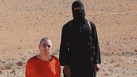 Jihadi John with his victim