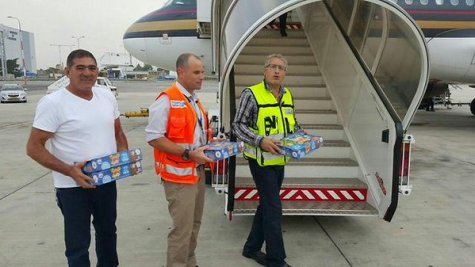 Passengers on the flight from Dubai receive Krembos after landing in Israel.