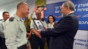Defense Minister Liberman looking at his own 1979 recruit's photo at the IDF reception and screening center. / Facebook