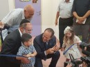 Shalva founder, Kalman Samuels (left), and Mayor of Jerusalem, Nir Barkat (center), help youngsters cut the ribbon at the grand opening of the new National Children's Center last week.