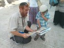 Newest MK Yehuda Glick with constituent. / Wikipedia commons