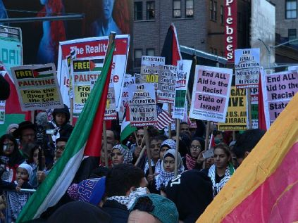 "Pro-Palestinian Arab signs read, ""No Justice, No Peace"" -- a slogan stolen from recent Black rioters across the United States, taken originally from the mantra chanted by Black rioters in the Crown Heights section of Brooklyn during the 3-day pogrom in Aug. 1991."